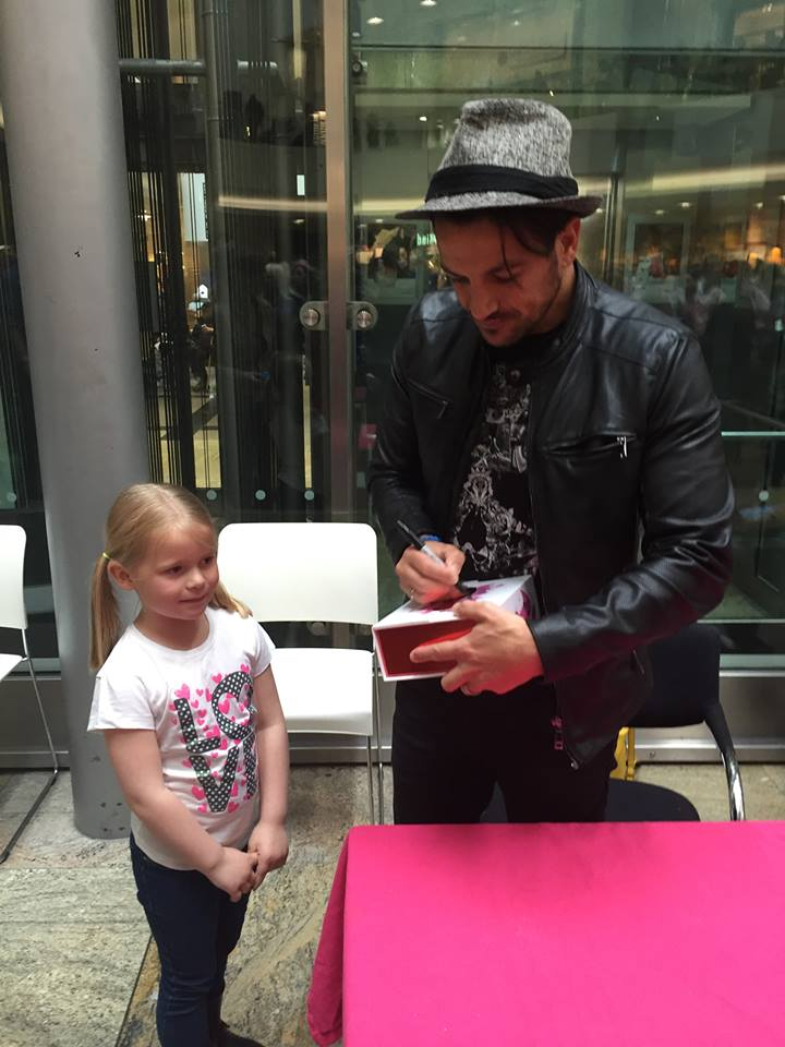 Peter Andre signing a CD for Rebecca Stanton's, 29, duaghter, Taylor, six.