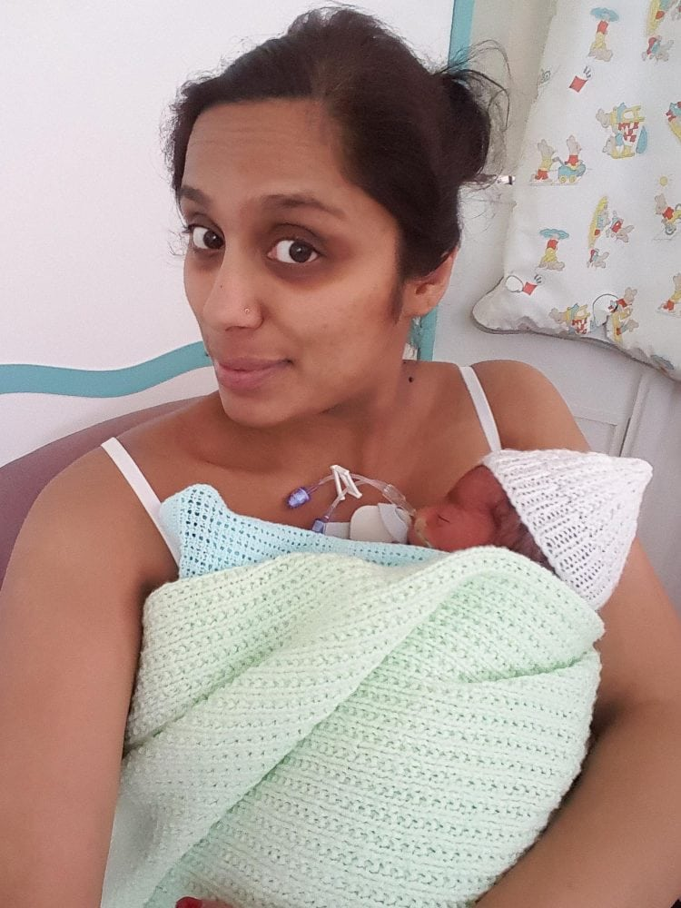 COLLECT PICTURE taken 24/06/2016 of Vimla Patel with one of he triplets while in Kettering General Hospital Wellingborough, Northamptonshire. Vimla mother of-three became a mum-of-six overnight when, after taking a month off the pill before starting a new career, she fell pregnant with identical triplet boys.