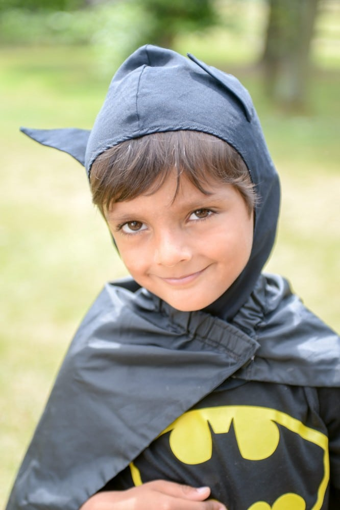 Zavi Ahmed helped rescue 1 year old Iris when she got locked in a car by mistake. July 15 2015. See SWNS story SWBATMAN; A one-year-old girl trapped in a scorching car on a hot summer's day was rescued by a five-year-old hero - dressed as BATMAN. Real life superhero Zavi Ahmed swooped to the rescue after police were unable to free the trapped tot from the Volkswagen Beetle. They smashed the rear window but they couldn't fit inside to open the doors or fetch the keys. But officers were stunned when Zavi - dressed as The Caped Crusader - wandered over with his mum and offered to help. Zavi had begged his mum Emma, 32, to dress up as his favourite superhero that morning but never expected to come to the rescue of complete stranger Iris Adamski.