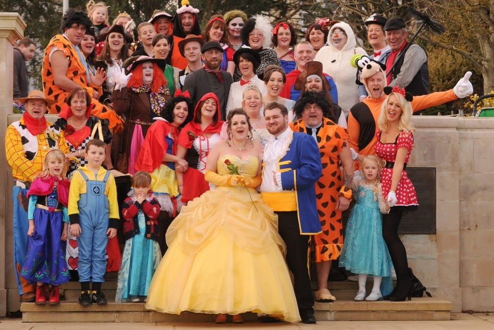 "Toni Stapleton and Eric Orford in their Disney themed fancy dress wedding. See SWNS story SWDISNEY A couple have told how they enjoyed a fairytale wedding ceremony -- with everyone involved dressing up as DISNEY CHARACTERS. Toni and Eric Orford decided they wanted to keep their nuptials as relaxed as possible, without losing the romance. Toni, 32, asked her partner, Eric, 25, who she met while working on a banana farm in Australia, how he'd feel about dressing up to exchange vows. Eric, a biology student, agreed and suggested ""The Beast"" for his attire, inspiring Toni to dress up as Belle, from Beauty and the Beast."