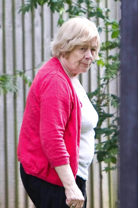 """Kathleen Neal (76). A 76-year-old snobby neighbour-from-hell has been slapped with an injunction after she tormented a couple for 12 years - because they lived in a council house. See NTI story NTISNOB. Nightmare neighbour Kathleen Neal started her 12-year campaign of terror against retired Sue, 65, and Keith Brookes, 68, who she told to """"get back to their council house"""". The vindictive pensioner started harassing the married couple in 2002 by lighting up to four bonfires a day and wafting the smoke over their fence. Neal then started clambering through wires and over a 5ft fence to get into the Brookes' back garden where she threw over their wheelie bins. She even covered their plants and lawn with weedkiller which she also sprayed through gaps in the fence from her own property in Castle Donington, Leics. Neal also started making anonymous silent phone calls to the Brookes' landline using an anonymous pay-as-you-go mobile phone over a six-month period last year. Grandparents Sue and Keith complained to their local council and were forced to install CCTV cameras in their garden to gather evidence of their neighbour trespassing in their garden. Neal, who lives in a GBP400,000 detached three-bedroom house, continued the harassment despite warnings from police officers and North West Leicestershire District Council. But the pensioner has now been slapped with a five-year injunction at Derby County Court which makes her harassment a serious criminal offence if it continues."""