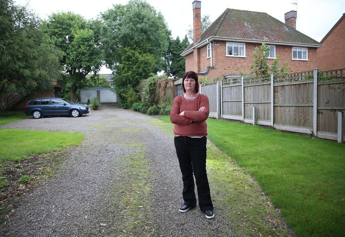 """Sue Brookes of Castle Donington, the victim of a 14 year long campaign of terror by her elderly neighbour. A 76-year-old snobby neighbour-from-hell has been slapped with an injunction after she tormented a couple for 12 years - because they lived in a council house. See NTI story NTISNOB. Nightmare neighbour Kathleen Neal started her 12-year campaign of terror against retired Sue, 65, and Keith Brookes, 68, who she told to """"get back to their council house"""". The vindictive pensioner started harassing the married couple in 2002 by lighting up to four bonfires a day and wafting the smoke over their fence. Neal then started clambering through wires and over a 5ft fence to get into the Brookes' back garden where she threw over their wheelie bins. She even covered their plants and lawn with weedkiller which she also sprayed through gaps in the fence from her own property in Castle Donington, Leics. Neal also started making anonymous silent phone calls to the Brookes' landline using an anonymous pay-as-you-go mobile phone over a six-month period last year. Grandparents Sue and Keith complained to their local council and were forced to install CCTV cameras in their garden to gather evidence of their neighbour trespassing in their garden. Neal, who lives in a GBP400,000 detached three-bedroom house, continued the harassment despite warnings from police officers and North West Leicestershire District Council. But the pensioner has now been slapped with a five-year injunction at Derby County Court which makes her harassment a serious criminal offence if it continues."""